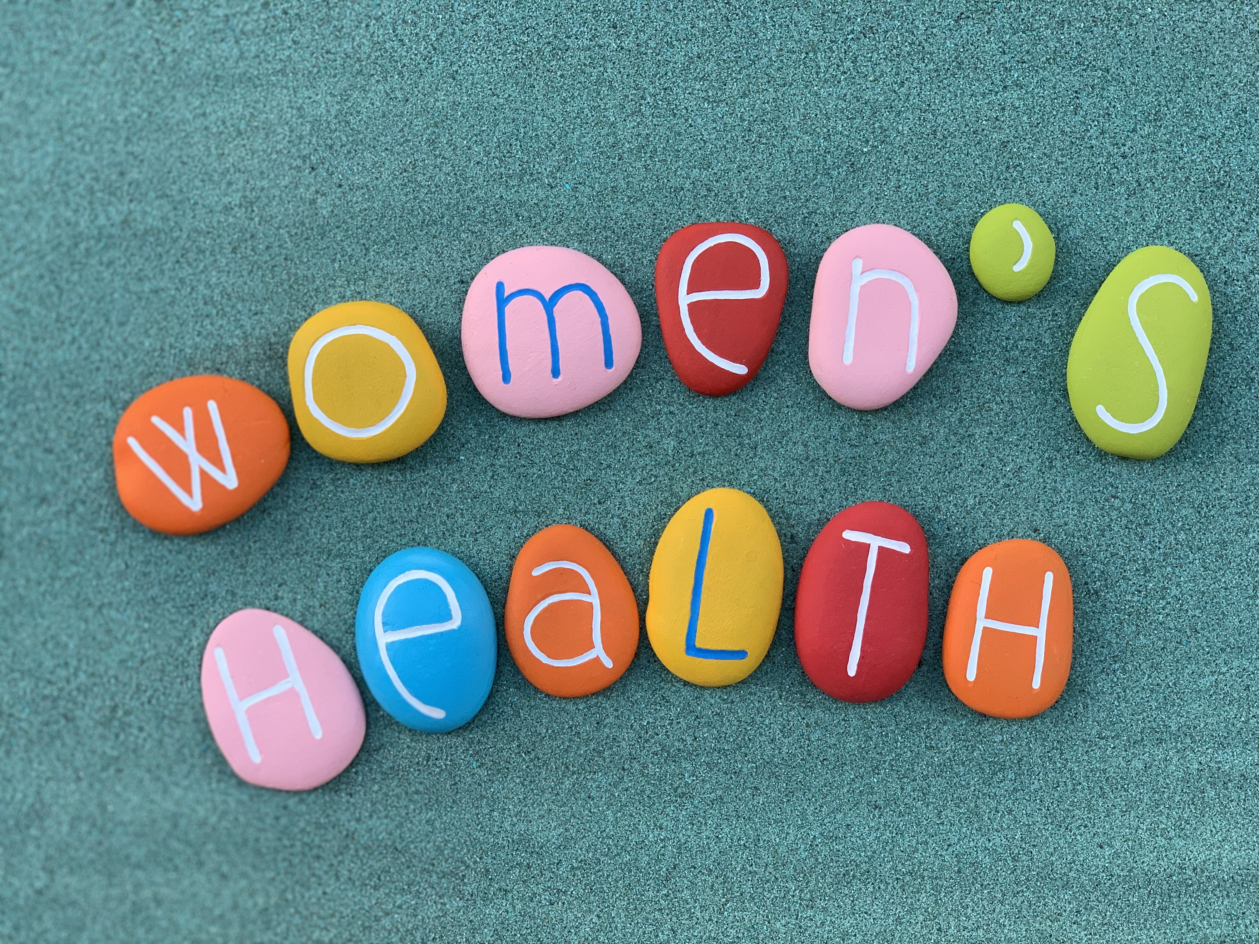 Multi-colored stones spelling out Women's Health
