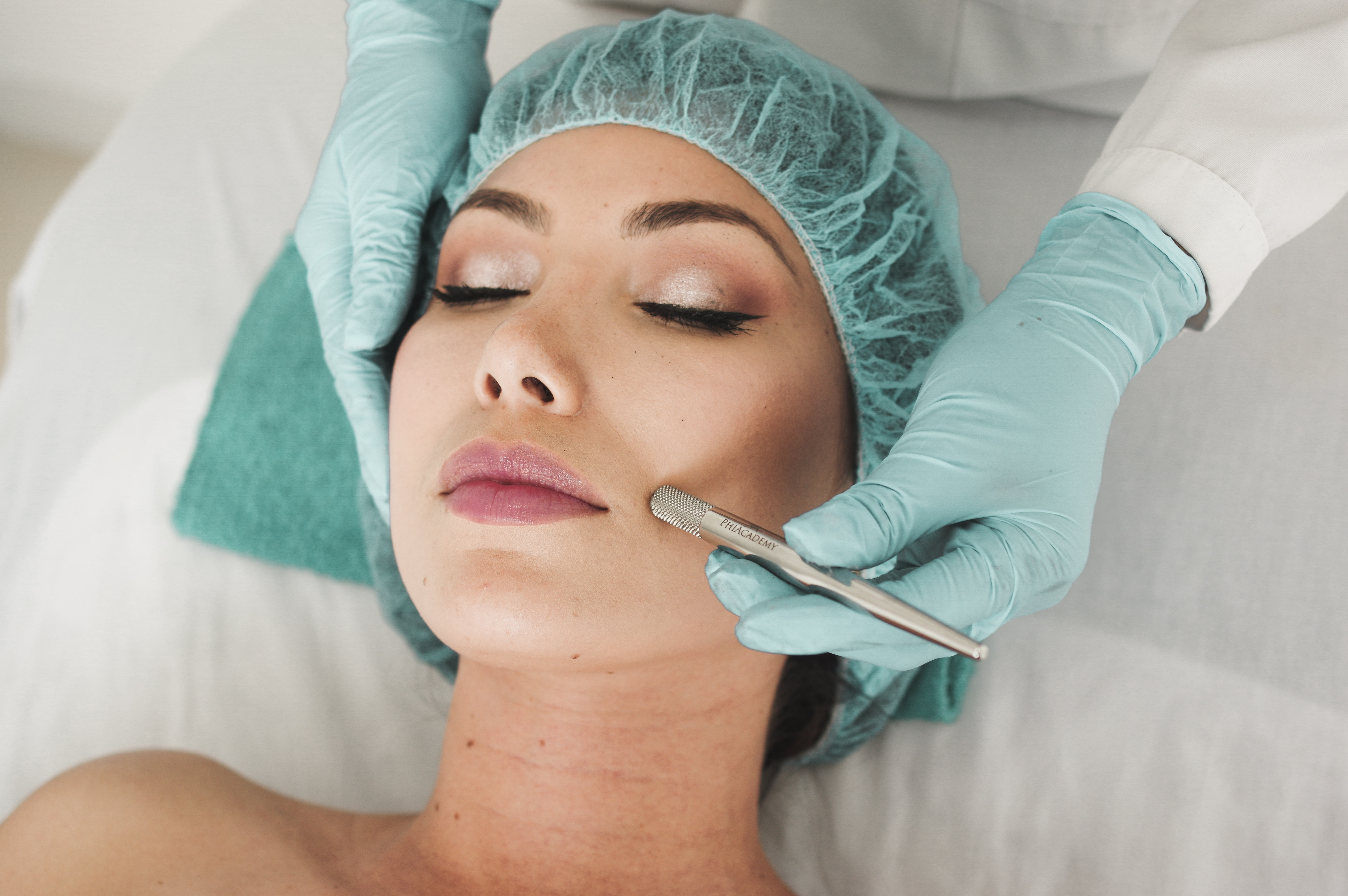 A woman in a medical spa receives a skin treatment