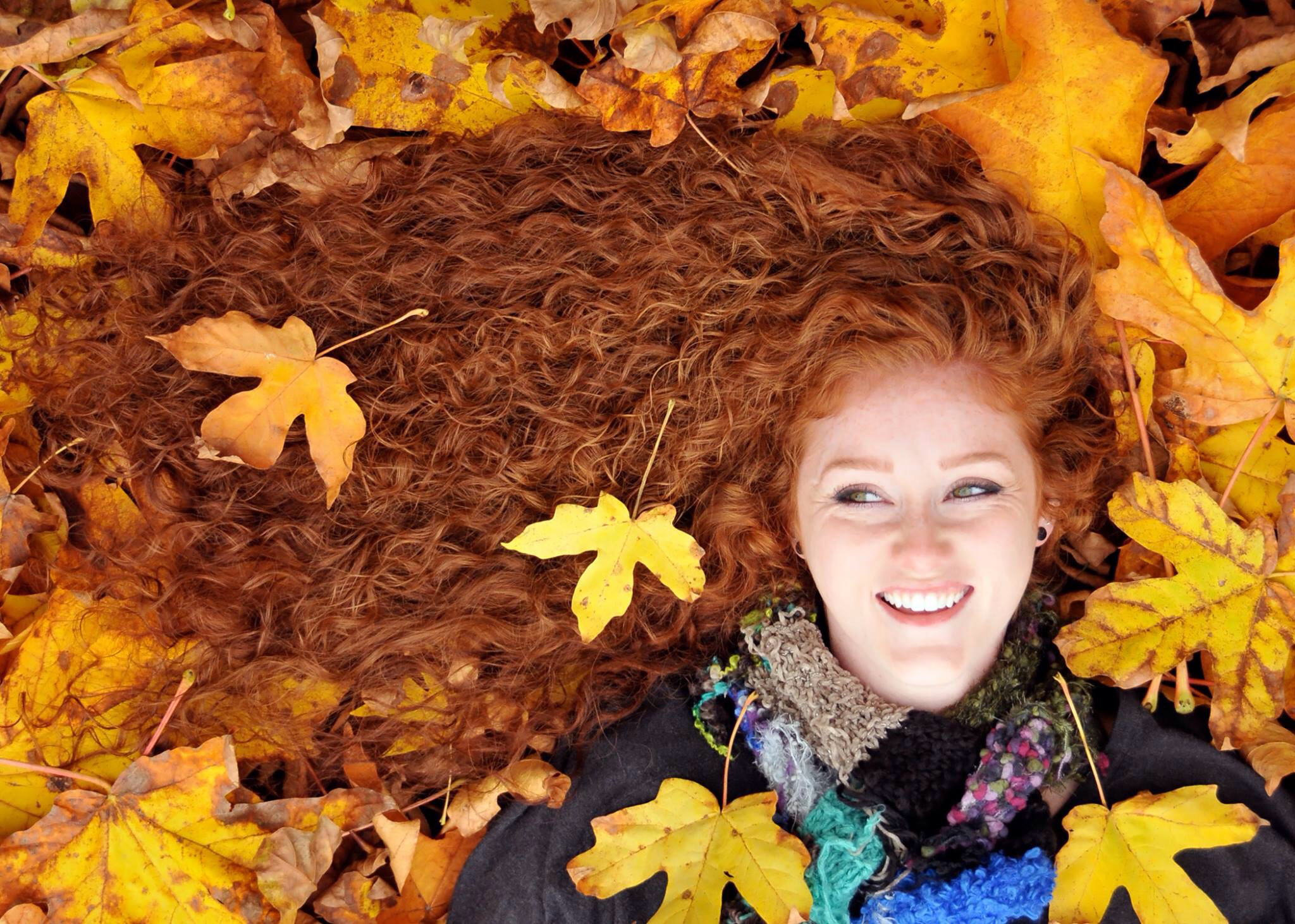 Red Head in Autumn Leaves
