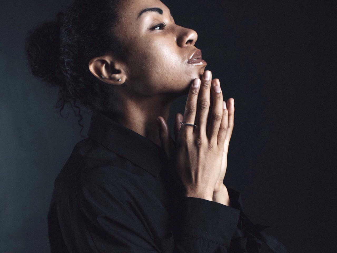 Stressed out woman rests chin on her hands